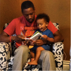 Flynn teaching his Dad to Read.